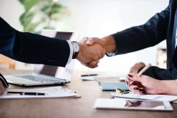 business lawyers shaking hands