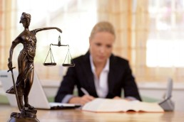 female lawyer at law desk